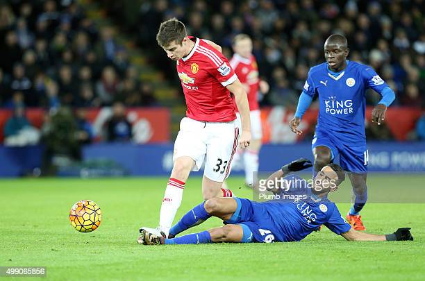 Riyad Mahrez of Leicester City in action with Paddy McNair of Manchester United during the Barclays Premier League match between Leicester City and...