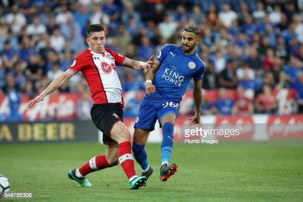Riyad Mahrez of Leicester City in action with PierreEmile Hojbjerg of Southampton during the Premier League match between Leicester City and...