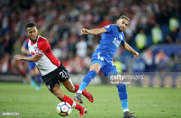 Riyad Mahrez of Leicester City in action with Ryan Bertrand of Southampton during the Premier League match between Leicester City and Southampton at...