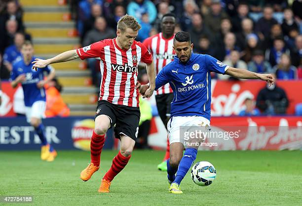 Riyad Mahrez of Leicester City in action with Steven Davis of Southampton during the Premier league match between Leicester City and Southampton at...