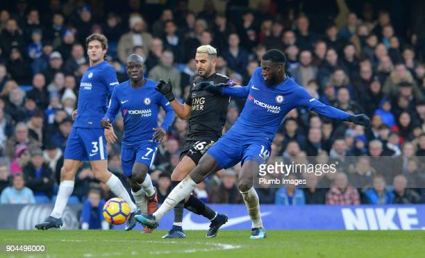 Riyad Mahrez of Leicester City in action with Tiemoue Bakayoko of Chelsea during the Premier League match between Chelsea and Leicester City at...
