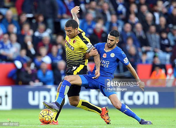 Riyad Mahrez of Leicester City in action with Troy Deeney of Watford during the Barclays Premier League match between Leicester City and Watford at...