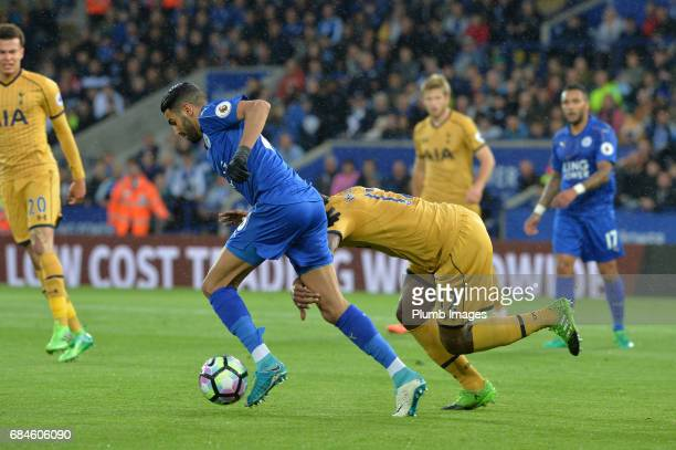 Riyad Mahrez of Leicester City in action with Victor Wanyama of Tottenham Hotspur during the Premier League match between Leicester City and...