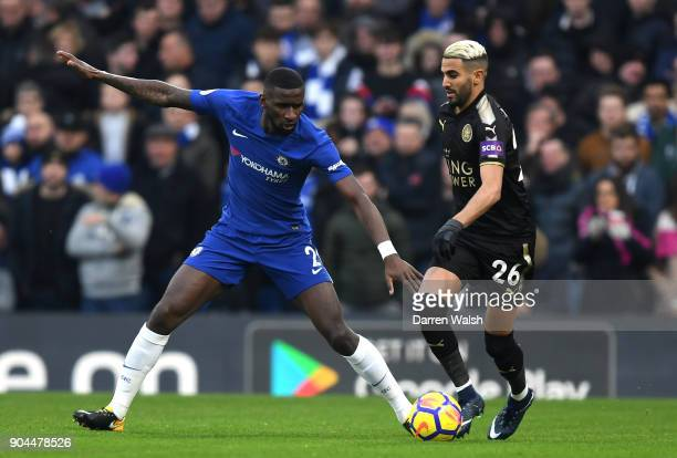 Riyad Mahrez of Leicester City is challenged by Antonio Rudiger of Chelsea during the Premier League match between Chelsea and Leicester City at...