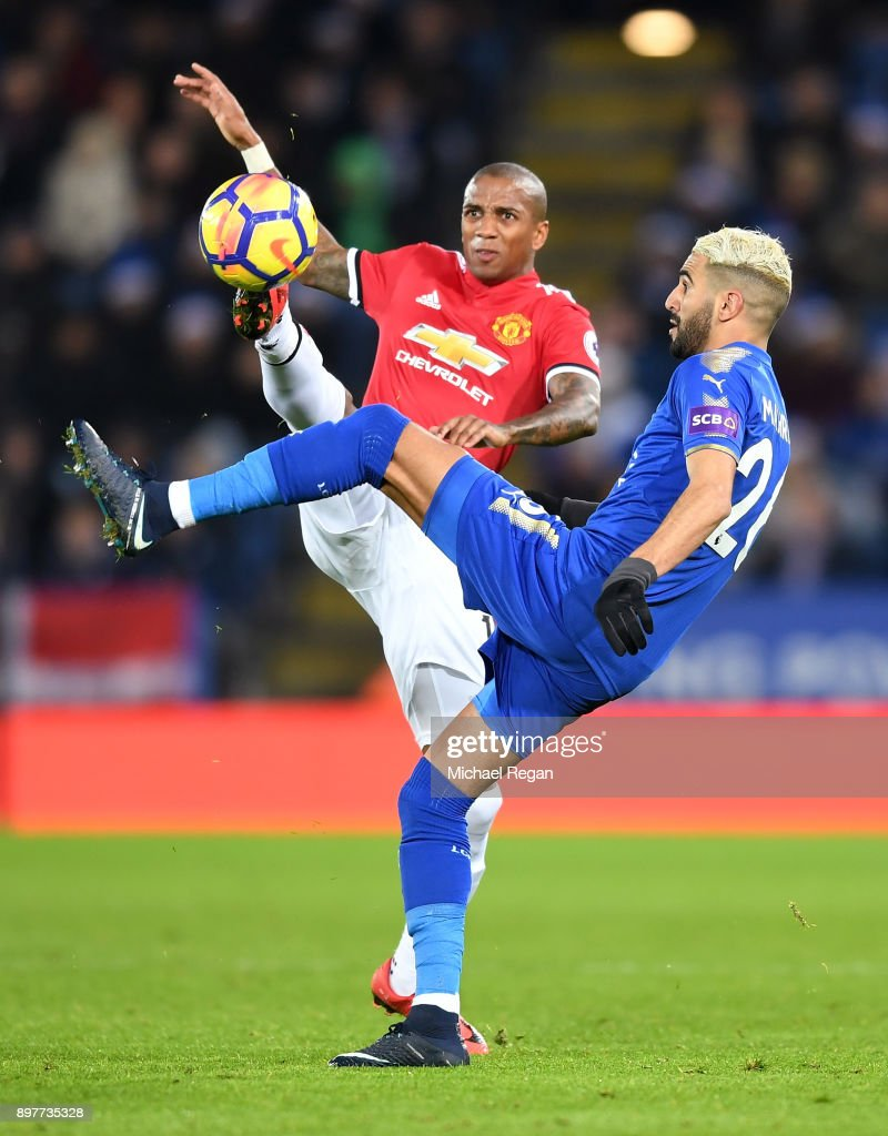 Riyad Mahrez of Leicester City is challenged by Ashley Young of Manchester United during the Premier League match between Leicester City and Manchester United at The King Power Stadium on December 23, 2017 in Leicester, England.
