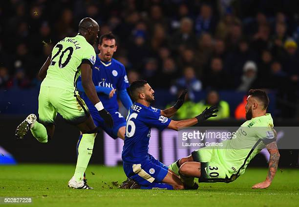 Riyad Mahrez of Leicester City is challenged by Nicolas Otamendi of Manchester City during the Barclays Premier League match between Leicester City...