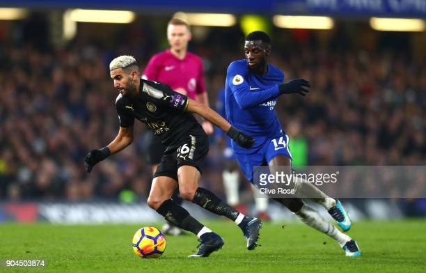 Riyad Mahrez of Leicester City is put under pressure by Tiemoue Bakayoko of Chelsea during the Premier League match between Chelsea and Leicester...