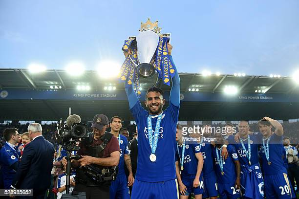 Riyad Mahrez of Leicester City lifts the Premier League Trophy as players and staffs celebrate the season champion after the Barclays Premier League...