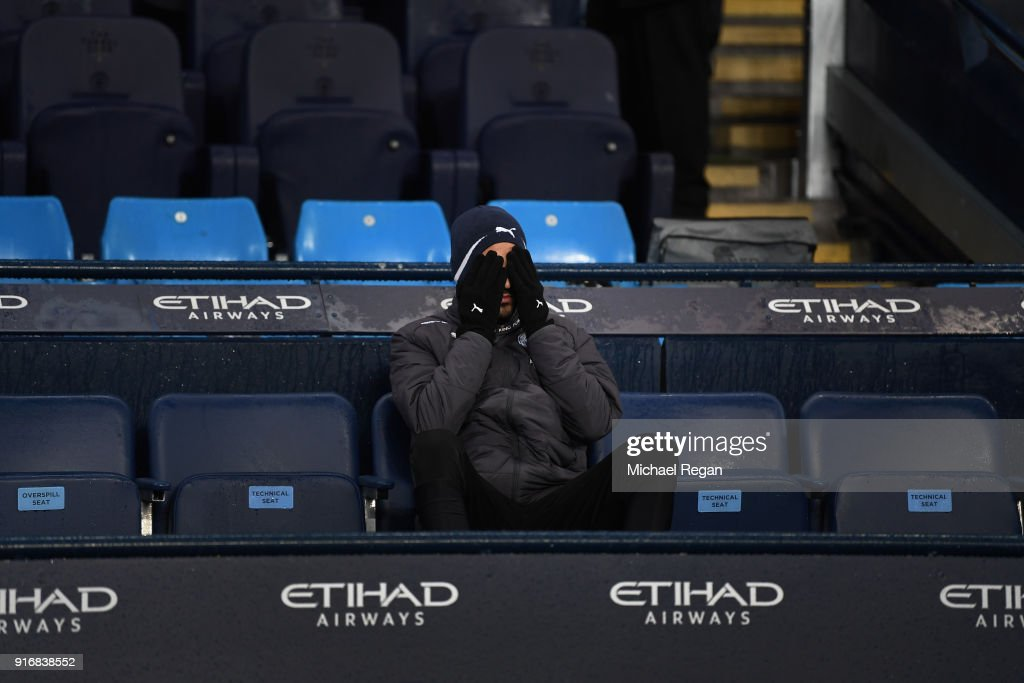 Riyad Mahrez of Leicester City looks on from the bench during the Premier League match between Manchester City and Leicester City at Etihad Stadium on February 10, 2018 in Manchester, England.
