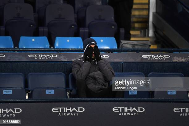 Riyad Mahrez of Leicester City looks on from the bench during the Premier League match between Manchester City and Leicester City at Etihad Stadium...