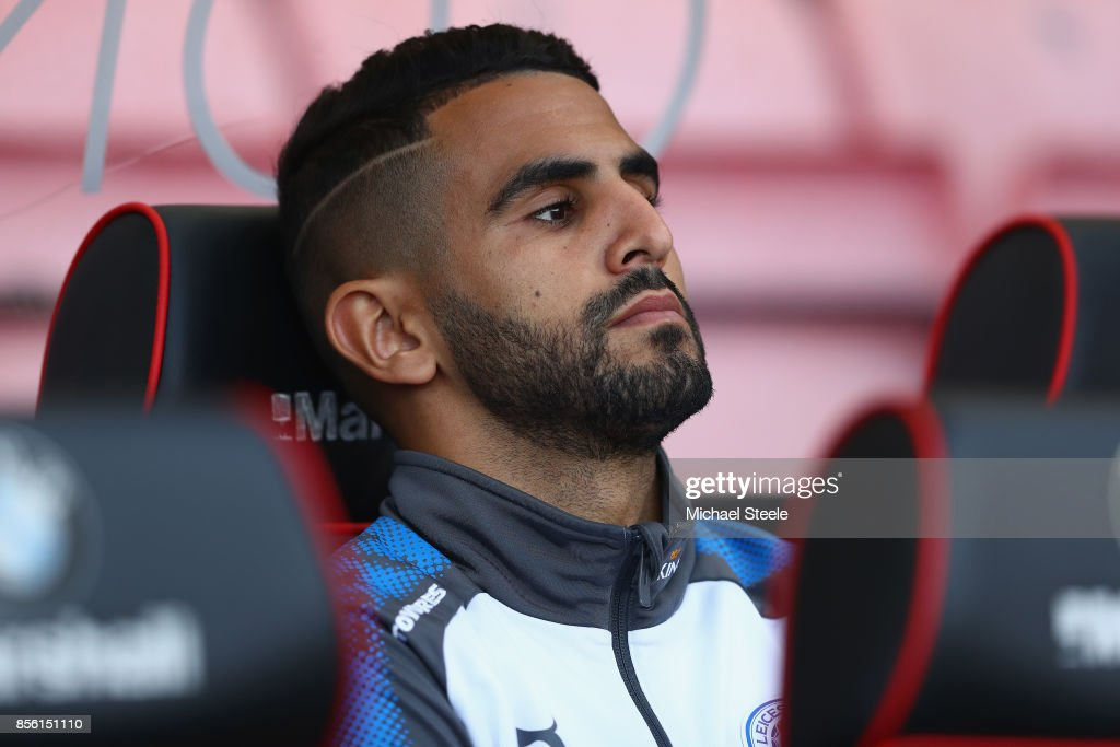 Riyad Mahrez of Leicester City looks on from the substitutes bench during the Premier League match between AFC Bournemouth and Leicester City at Vitality Stadium on September 30, 2017 in Bournemouth, England.
