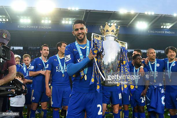 Riyad Mahrez of Leicester City poses with the Premier League Trophy as players and staffs celebrate the season champion after the Barclays Premier...