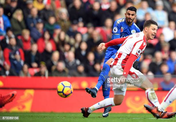 Riyad Mahrez of Leicester City scores a goal to make it 1-2 during the Premier League match between Stoke City and Leicester City at Bet365 Stadium...