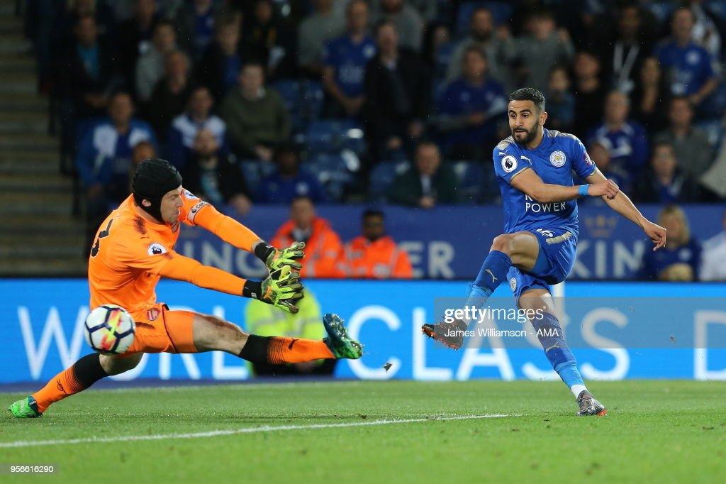 Riyad Mahrez of Leicester City scores a goal to make it 3-1 during the Premier League match between Leicester City and Arsenal at The King Power Stadium on May 9, 2018 in Leicester, England.