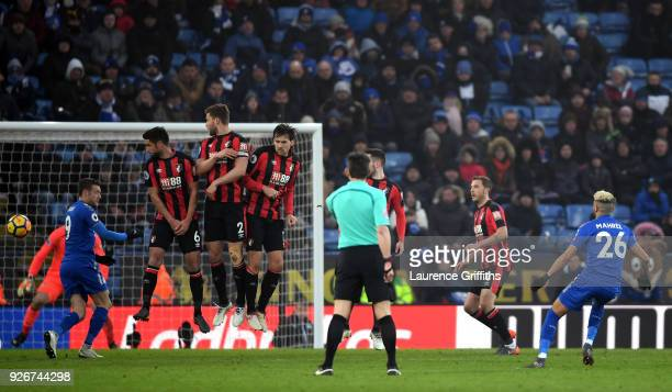 Riyad Mahrez of Leicester City scores his sides first goal during the Premier League match between Leicester City and AFC Bournemouth at The King...