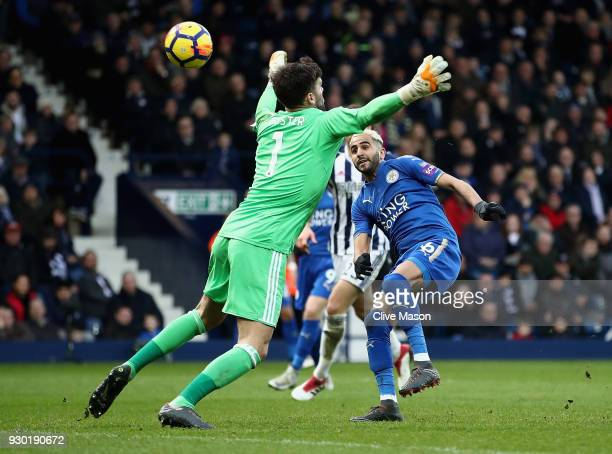Riyad Mahrez of Leicester City scores his sides second goal past Ben Foster of West Bromwich Albion during the Premier League match between West...