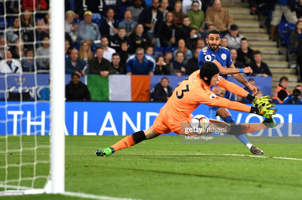Riyad Mahrez of Leicester City scores his sides third goal past Petr Cech of Arsenal during the Premier League match between Leicester City and Arsenal at The King Power Stadium on May 9, 2018 in Leicester, England.