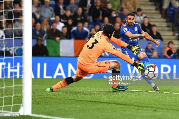 Riyad Mahrez of Leicester City scores his sides third goal past Petr Cech of Arsenal during the Premier League match between Leicester City and...