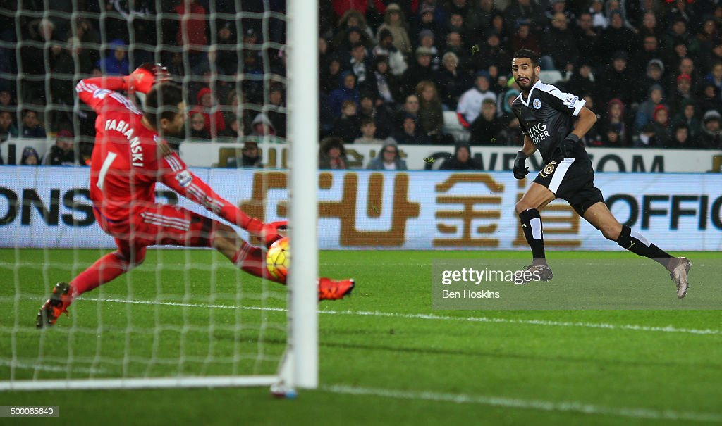 Riyad Mahrez of Leicester City scores his team's third and hat trick goal during the Barclays Premier League match between Swansea City and Leicester City at Liberty Stadium on December 5, 2015 in Swansea, Wales.