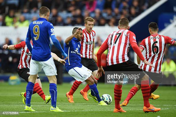 Riyad Mahrez of Leicester City scores the opening goal during the Barclays Premier League match between Leicester City and Southampton at The King...