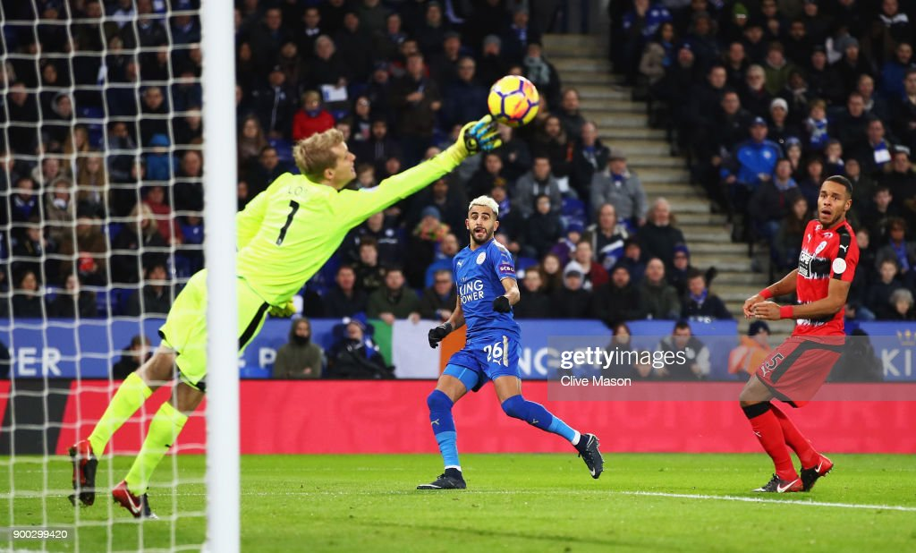 Riyad Mahrez of Leicester City scores the opening goal during the Premier League match between Leicester City and Huddersfield Town at The King Power Stadium on January 1, 2018 in Leicester, England.