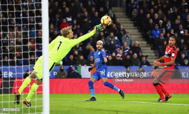 Riyad Mahrez of Leicester City scores the opening goal during the Premier League match between Leicester City and Huddersfield Town at The King Power...
