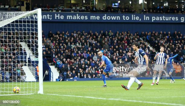 Riyad Mahrez of Leicester City sees the ball hit the back of the net after chipping the ball over Ben Foster of West Bromwich Albion to make it 12...