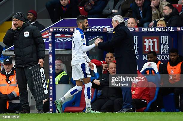 Riyad Mahrez of Leicester City shakes hands with manager Claudio Ranieri as he is replaced during the Barclays Premier League match between Crystal...