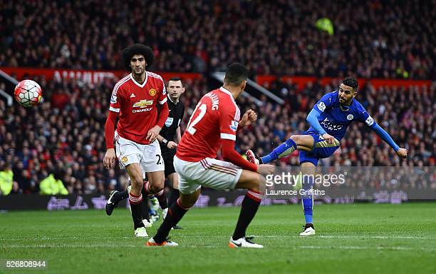 Riyad Mahrez of Leicester City shoots during the Barclays Premier League match between Manchester United and Leicester City at Old Trafford on May 1...