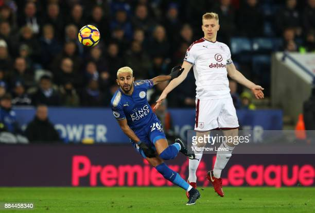 Riyad Mahrez of Leicester City shoots past Ben Mee of Burnley during the Premier League match between Leicester City and Burnley at The King Power...