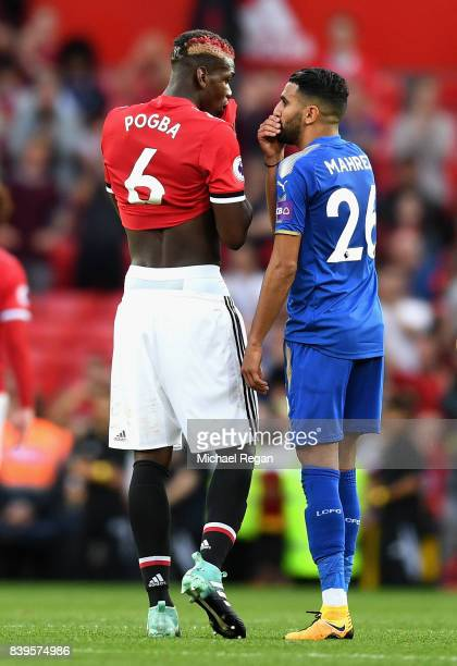 Riyad Mahrez of Leicester City speaks with Paul Pogba of Manchester United following the Premier League match between Manchester United and Leicester...