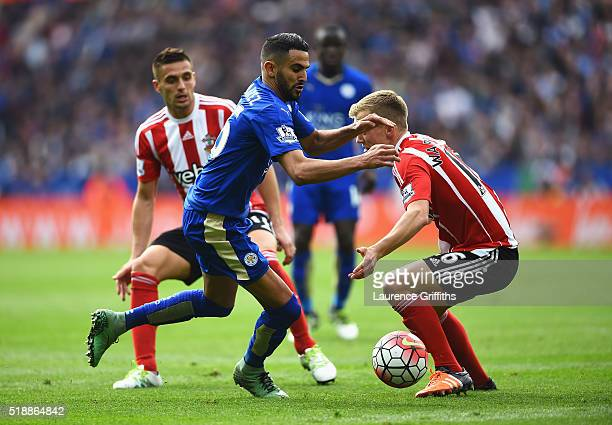 Riyad Mahrez of Leicester City takes on Dusan Tadic and James WardProwse of Southampton during the Barclays Premier League match between Leicester...