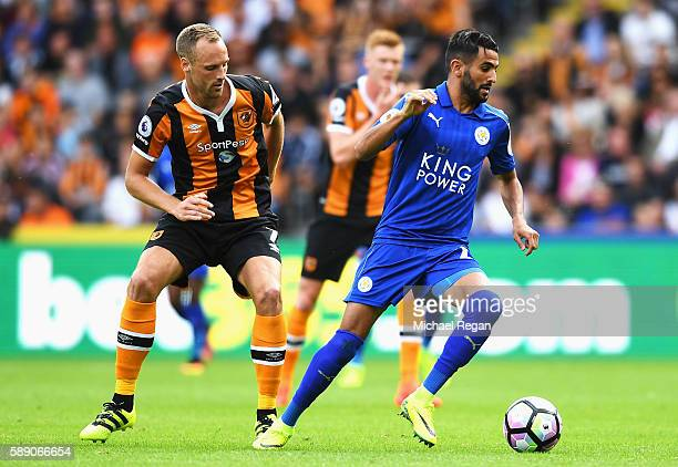 Riyad Mahrez of Leicester City takes the ball away from David Meyler of Hull City during the Premier League match between Hull City and Leicester...