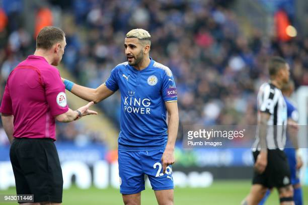 Riyad Mahrez of Leicester City talks to referee Stuart Attwell during the Premier League match between Leicester City and Newcastle United at King...