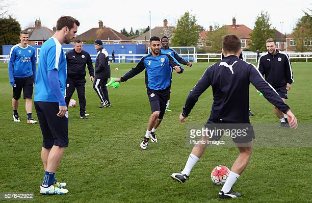 Riyad Mahrez of Leicester City warms up with team mates during a Leicester City training session at Belvoir Drive Training Ground on May 3, 2016 in...