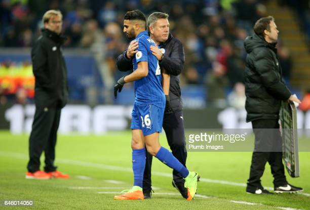 Riyad Mahrez of Leicester City with Interim first team manager Craig Shakespeare of Leicester City during the Premier League match between Leicester...