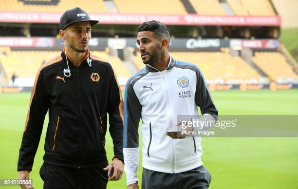 Riyad Mahrez of Leicester City with Romain Saiss of Wolverhampton Wanderers at Molineux Stadium ahead of the pre season friendly between...