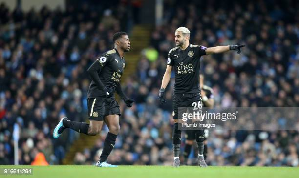 Riyad Mahrez of Leicester gives instructions to Kelechi Iheanacho of Leicester City during the Premier League match between Manchester City and...