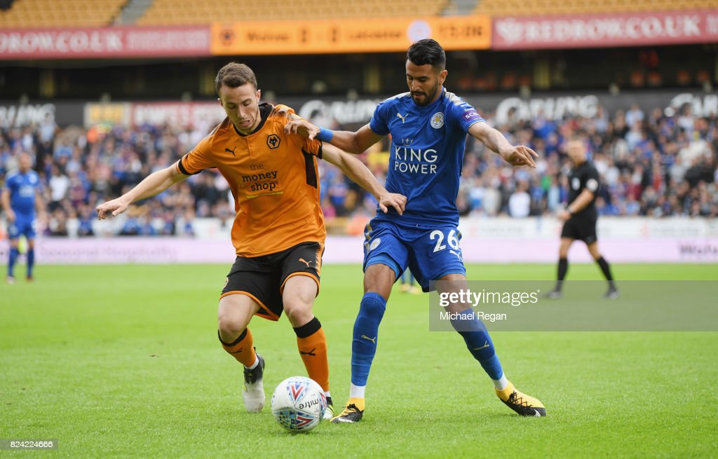 Riyad Mahrez of Leicester in action with Barry Douglas of Wolves during the pre-season friendly match between Wolverhampton Wanderers and Leicester City at Molineux on July 29, 2017 in Wolverhampton, England.