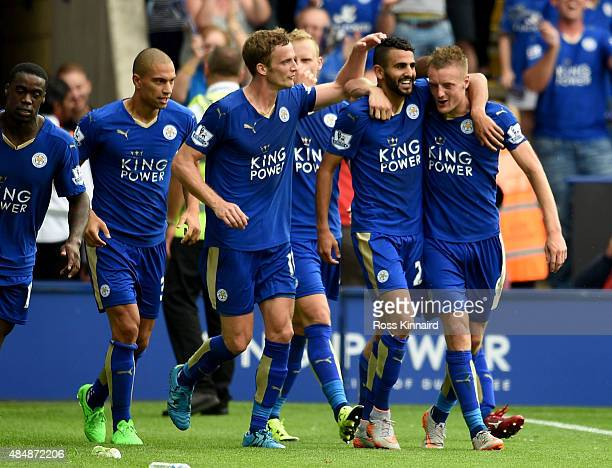 Riyad Mahrez of Leicester is congratulated after scoring during the Barclays Premier League match between Leicester City and Tottenham Hotspur at the...