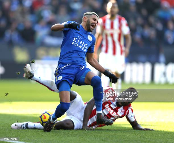 Riyad Mahrez of Leicester is fouled by Maxim ChoupoMoting of Stoke during the Premier League match between Leicester City and Stoke City at The King...