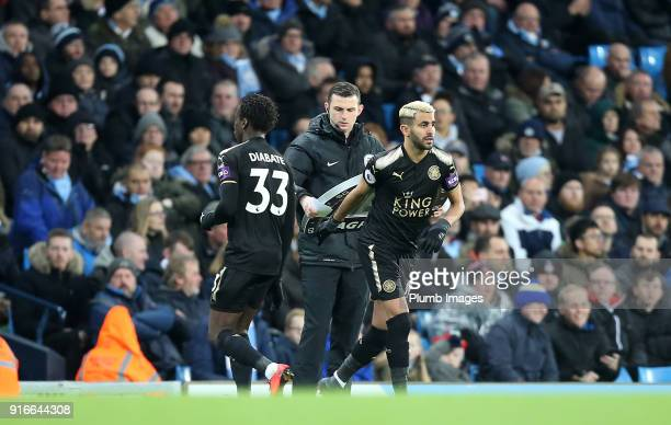 Riyad Mahrez of Leicester replaces Fousseni Diabate of Leicester City during the Premier League match between Manchester City and Leicester City at...