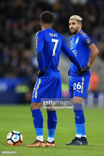 Riyad Mahrez of Leicester speaks to teammate Demarai Gray during The Emirates FA Cup Third Round Replay match between Leicester City and Fleetwood...