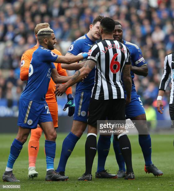 Riyad Mahrez of Leicester tries to separate Harry Maguire of Leicester as he confronts Jamaal Lascelles of Newcastle during the Premier League match...