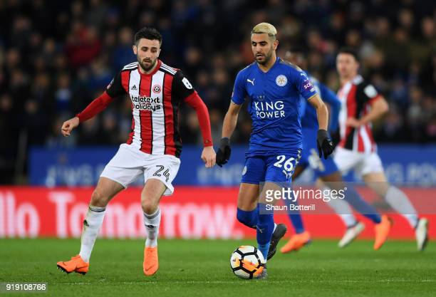 Riyad Mahrez of Leicester under pressure from Daniel Lafferty of Sheffield United The Emirates FA Cup Fifth Round match between Leicester City and...