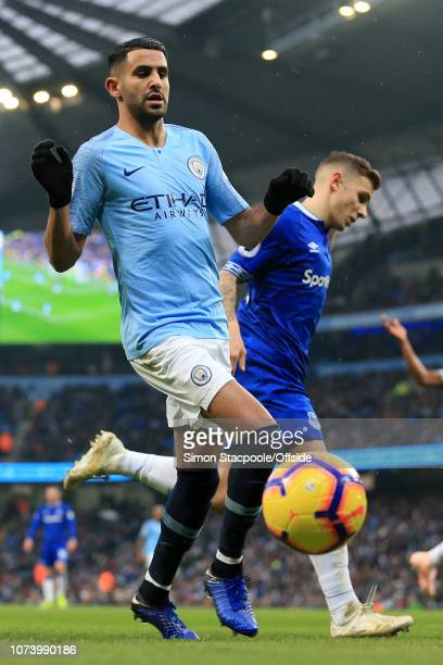 Riyad Mahrez of Man City battles with Lucas Digne of Everton during the Premier League match between Manchester City and Everton at the Etihad...