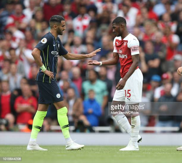 Riyad Mahrez of Man City sportingly consoles Ainsley MaitlandNiles of Arsenal as he has to depart with an injury during the Premier League match...