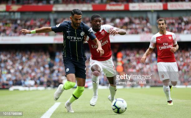 Riyad Mahrez of Manchester City and Ainsley MaitlandNiles of Arsenal during the Premier League match between Arsenal FC and Manchester City at...