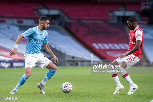 Riyad Mahrez of Manchester City and Ainsley MaitlandNiles of Arsenal in action during the FA Cup Semi Final match between Arsenal and Manchester City...