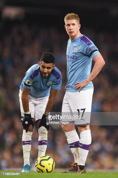 Riyad Mahrez of Manchester City and Kevin De Bruyne of Manchester City look on as a free kick prepares to be taken during the Premier League match...